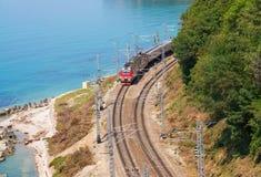 Train travels along the seashore Royalty Free Stock Image