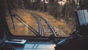 The train travels through the autumn forest. View through the windshield from the driver`s seat. Rails ahead. Beauty world, travel lifestyle, holidays and stock video