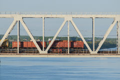 Train travels bridge over the river in summer Royalty Free Stock Photography