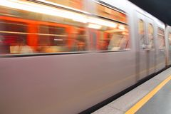 Train that travels fast in the underground station on track Stock Image