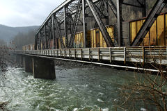 Train Trestle. Train on trestle over river on a rainy day Stock Image