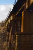 Train Trestle. /plate girder bridge over a small creek during the Georgia wintertime with strong warm directional lighting Royalty Free Stock Photos