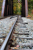 Train Trestle. Train tracks leading to a trestle with fall foliage beyond Royalty Free Stock Photos