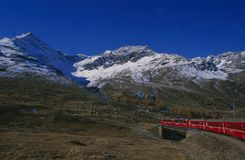 Train trip, Rhätische Bahn, swiss alps, Lago Bianco, Bernina Pa. Switzerland: Train trip with Rhätische Bahn through the swiss alps at Lago Bianco on Bernina Stock Images