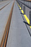 Train or trolley track. Details of train or trolley tracks near a pedestrian walkway or platform Stock Photography