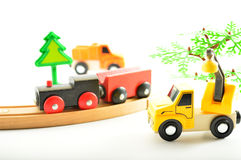 Train and truck, crane. Toys for children. Stock Photos