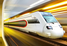 Train in tunnel. Super streamlined train with motion blur moves in tunnel Stock Photography