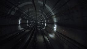 Train tunnels pov view. Pov view, subway train starts his moving from one station to other in the end, through curved web of city underground tunnels, meeting stock video footage