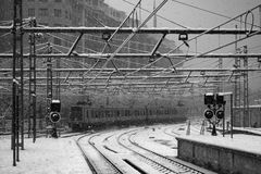 Train under the snow. A train arriving to the station under a snowfall Stock Photography
