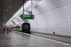 Train at underground railway station. Train standing at Triangeln underground railway station in Malmo (Sweden) with passengers in motion blur Royalty Free Stock Image