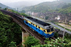 Train on viaduct,southwest mountain area,China Royalty Free Stock Photo