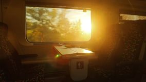 Train journey sunset light. Train view with flashing sunlight at sunset stock video