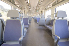 Train wagon indoor with nobody empty seats Royalty Free Stock Photo