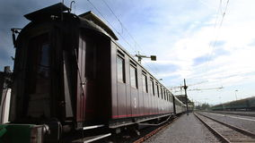Train wagon waiting on a railway sation on a suny day stock video footage