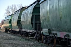 City junction railway yard on which sorting of freight railway trains takes place. Train wagons in row on the rails at railway station. Freight train. Cargo Royalty Free Stock Photos