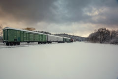 Train wagons in snowy winter landscape Royalty Free Stock Images