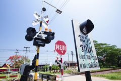 Train warning sign at the intersection road.  Royalty Free Stock Photos