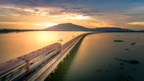 The train was running at high speed through a railway bridge Ove. R Lake Pa Sak Dam Lopburi Thailand Beautiful Sunset Stock Images