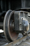 Train wheel. Rusty and polished freight train wheel on railroad track stock photos