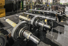 Train wheel axle with pinion. Details wheelset train unassembled Stock Photography