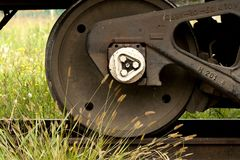 Train wheel and grass Royalty Free Stock Photo