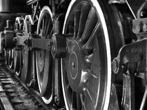 Train Wheels in Black and White. Four wheels on a steam engine train Royalty Free Stock Images