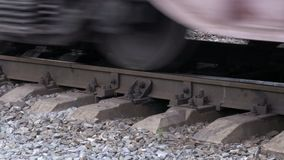 Train wheels on the rails. Movement of freight trains stock video
