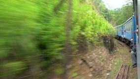 Train winding it`s way through The Highlands & tea estates stock footage