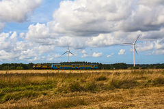 Train windmill wind turbines farm landscape field Stock Photo