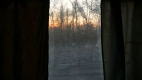 Train window landscape move. View from a train window at the passing landscape stock video footage