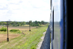 From the train window. Photo taken from the window of a train in motion Stock Photos