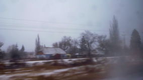 Train window view snow winter forest water. Train window view snow winter rain stock footage