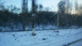 Train window winter rain. Train window view snow winter rain stock footage