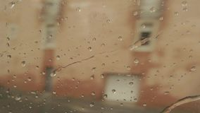 Train window with water drops. Blurred landscape at daytime. Leave and never return stock video footage