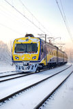 Train in winter. A city train on snow covered tracks stock image