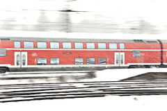 Train in Wintertime on track in  snow flurry Royalty Free Stock Photography