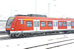 Train in Wintertime on track in  snow flurry Royalty Free Stock Photo