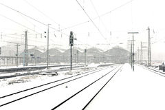 Train in Wintertime on track in  snow flurry Stock Photography