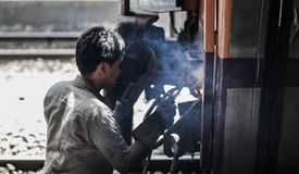 Train. Worker repairing train by joining Royalty Free Stock Image
