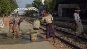 TRAIN WORKERS: 3-shot workers fixing train platform stock video