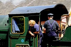 Train workers on Steam Locomotive footplate. Royalty Free Stock Photos