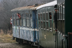 Train workshops with running bridge. Brad, Romania, December12, 2009: Tourists are travel in an old steamed cog train in Brad, on winter holydays Royalty Free Stock Photos