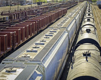 Train yard. Cargo trains in a large trainyard stock image