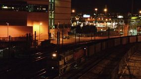 Train yards at night. The caboose of a train moving along at night stock video