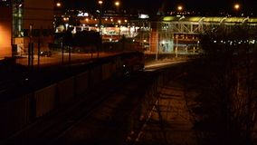Train yards at night. A freight train in the city at night stock footage