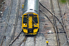 Train. Yellow train on a railroad track from a height Royalty Free Stock Photography