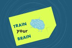 Train your brain message on yellow note Stock Photography