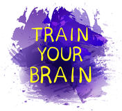 `Train your brain` text on purple paint splash backdrop. VECTOR hand drawn letters. Yellow words. Stock Photos