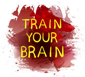 `Train your brain` text on purple paint splash backdrop. VECTOR hand drawn letters. Yellow words. Royalty Free Stock Photos