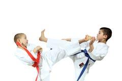 Trained athletes are beating blows kicks Stock Photos
